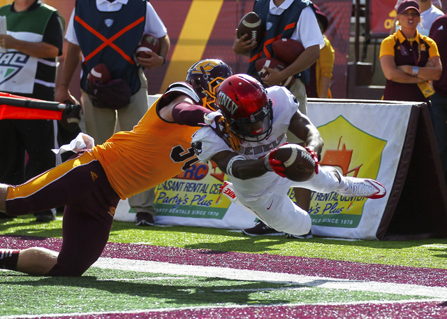 UNLV running back Lexington Thomas (3) comes up short at the end zone while being tackled by Central Michigan linebacker Alex Briones (30) during a football game at Kelly/Shorts Stadium in Mount P ...