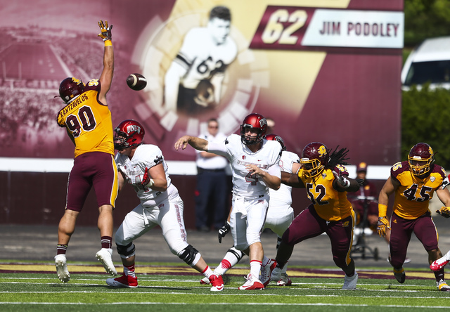 UNLV quarterback Johnny Stanton (4) throws a pass as Central Michigan defensive lineman Chris Kantzavelos (90) attempts to block it during a football game at Kelly/Shorts Stadium in Mount Pleasant ...
