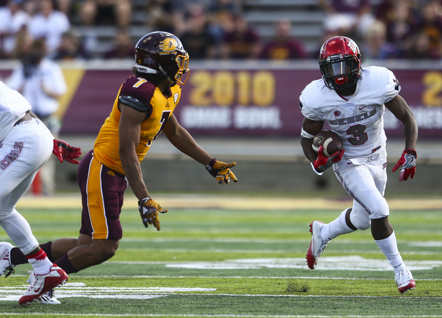 UNLV running back Lexington Thomas (3) runs the ball past Central Michigan defensive back Amari Coleman (7) during a football game at Kelly/Shorts Stadium in Mount Pleasant, Mich. on Saturday, Sep ...