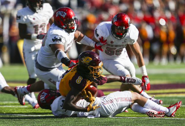 UNLV defensive players swarm Central Michigan wide receiver Corey Willis (8) during a football game at Kelly/Shorts Stadium in Mount Pleasant, Mich. on Saturday, Sept. 17, 2016. Chase Stevens/Las  ...