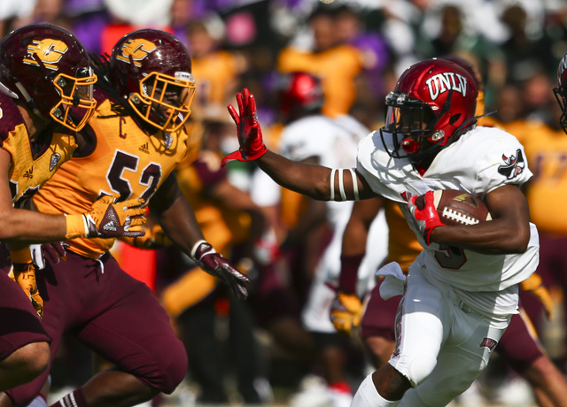 UNLV running back Lexington Thomas (3) looks to get past Central Michigan defense during a football game at Kelly/Shorts Stadium in Mount Pleasant, Mich. on Saturday, Sept. 17, 2016. Chase Stevens ...