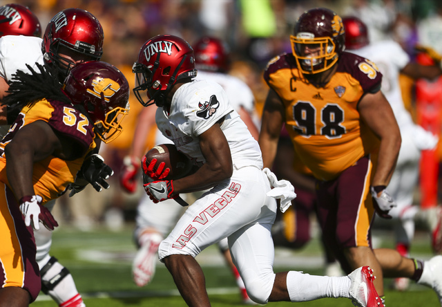 UNLV running back Lexington Thomas (3) makes an 85-yard run to score a touchdown during a football game at Kelly/Shorts Stadium in Mount Pleasant, Mich. on Saturday, Sept. 17, 2016. Chase Stevens/ ...