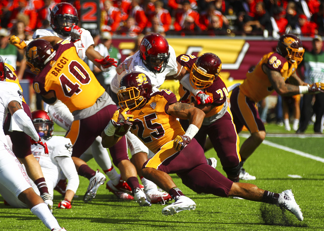 Central Michigan running back Devon Spalding (25) runs the ball against UNLV during a football game at Kelly/Shorts Stadium in Mount Pleasant, Mich. on Saturday, Sept. 17, 2016. Chase Stevens/Las  ...