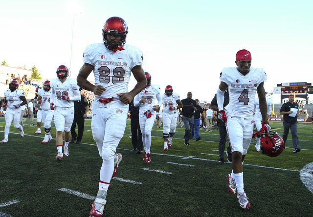 UNLV football players leave the field after losing to Central Michigan in a football game at Kelly/Shorts Stadium in Mount Pleasant, Mich. on Saturday, Sept. 17, 2016. Central Michigan won 44-21.  ...