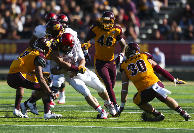 UNLV quarterback Johnny Stanton (4) is tackled by Central Michigan linebacker Nathan Ricketts (42) during a football game at Kelly/Shorts Stadium in Mount Pleasant, Mich. on Saturday, Sept. 17, 20 ...