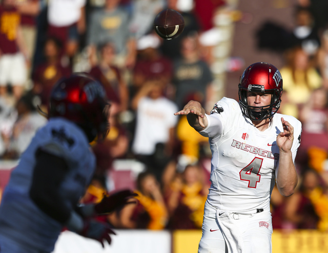 UNLV quarterback Johnny Stanton (4) throws a successful pass to UNLV running back Charles Williams (8) during a football game at Kelly/Shorts Stadium in Mount Pleasant, Mich. on Saturday, Sept. 17 ...