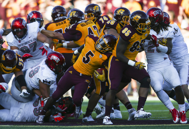 Central Michigan running back Jonathan Ward (5) is tripped up by UNLV defense during a football game at Kelly/Shorts Stadium in Mount Pleasant, Mich. on Saturday, Sept. 17, 2016. Central Michigan  ...
