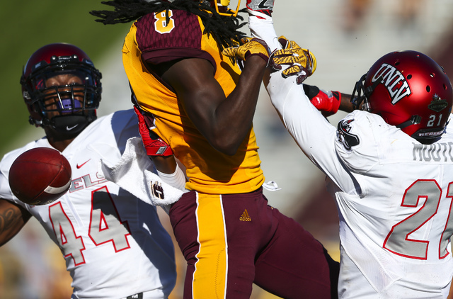 UNLV defensive back Kenny Keys (44) and UNLV defensive back Darius Mouton (21) break up as pass intended for Central Michigan wide receiver Corey Willis (8) during a football game at Kelly/Shorts  ...