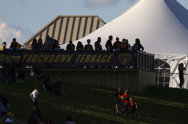 Children play in the grass as people watch UNLV take on Central Michigan in a football game at Kelly/Shorts Stadium in Mount Pleasant, Mich. on Saturday, Sept. 17, 2016. Central Michigan won 44-21 ...