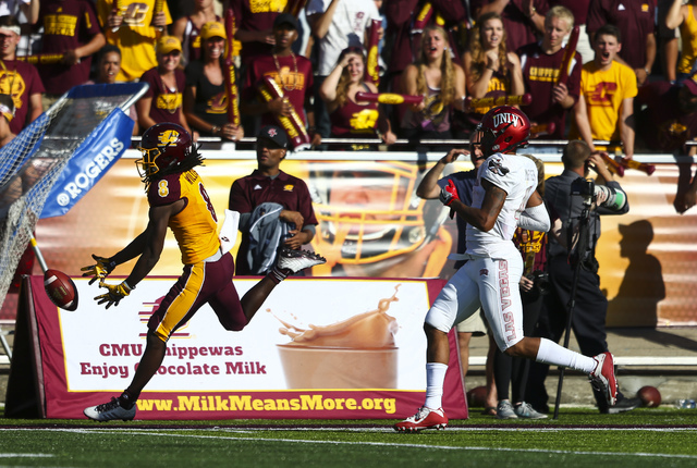 Central Michigan wide receiver Corey Willis (8) misses a pass as UNLV defensive back Torry McTyer (4) defends during a football game at Kelly/Shorts Stadium in Mount Pleasant, Mich. on Saturday, S ...