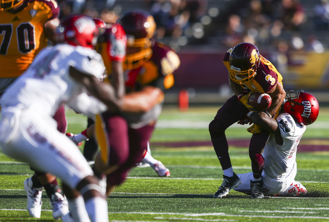 UNLV defensive back Tim Hough (13) takes down Central Michigan wide receiver Mark Chapman (3) during a football game at Kelly/Shorts Stadium in Mount Pleasant, Mich. on Saturday, Sept. 17, 2016. C ...