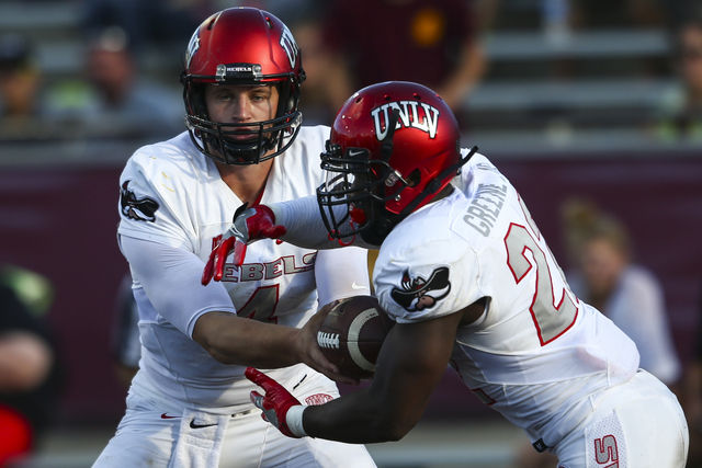 UNLV quarterback Johnny Stanton (4) hands the ball off to UNLV running back David Greene (22) during a football game at Kelly/Shorts Stadium in Mount Pleasant, Mich. on Saturday, Sept. 17, 2016. C ...