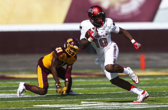 UNLV wide receiver Darren Woods Jr. (10) runs the ball against Central Michigan during a football game at Kelly/Shorts Stadium in Mount Pleasant, Mich. on Saturday, Sept. 17, 2016. Central Michiga ...