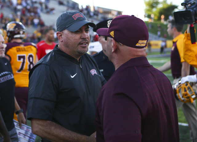UNLV head coach Tony Sanchez, left, greets Central Michigan head coach John Bonamego after a football game at Kelly/Shorts Stadium in Mount Pleasant, Mich. on Saturday, Sept. 17, 2016. Central Mic ...