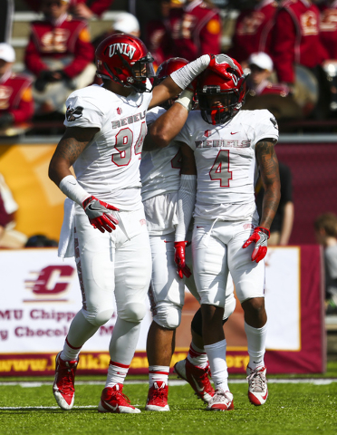 UNLV defensive lineman Jeremiah Valoaga (94) reacts after UNLV defensive back Torry McTyer (4) blocked a pass from Central Michigan during a football game at Kelly/Shorts Stadium in Mount Pleasant ...