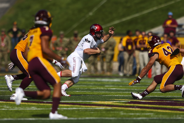 UNLV quarterback Johnny Stanton (4) runs the ball as Central Michigan linebacker Nathan Ricketts (42) looks to block him during a football game at Kelly/Shorts Stadium in Mount Pleasant, Mich. on  ...