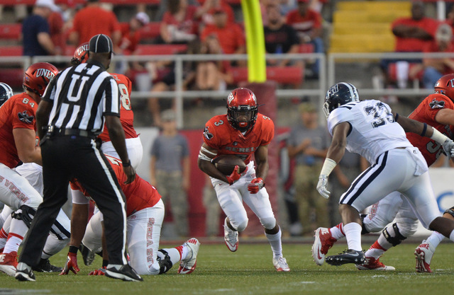 UNLV Rebels running back Lexington Thomas (3) rushes down field against Jackson State Tigers linebacker Shawn Bishop (33) in the first quarter during the UNLV Jackson State football game in Las Ve ...