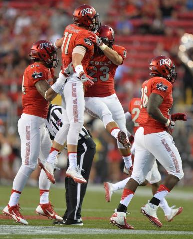UNLV Rebels defensive back Troy Hawthorne (11) and linebacker Matt Lea (23) celebrate Hawthorne's interception in the first quarter during the UNLV Jackson State football game in Las Vegas on Thur ...