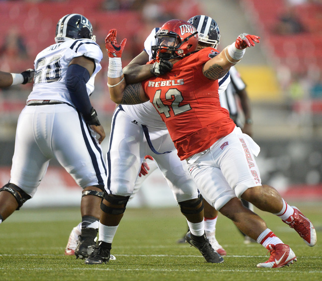 UNLV Rebels defensive lineman Salanoa-Alo Wily (42) rushes the Jackson State offensive line in the first quarter during the UNLV Jackson State football game in Las Vegas on Thursday, Sept. 1, 2016 ...