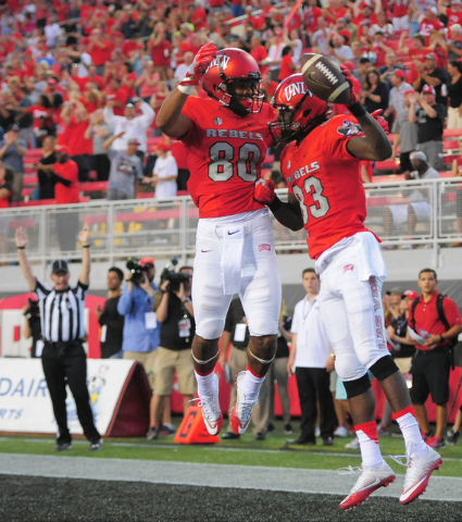 UNLV Rebels wide receiver Devonte Boyd (83) celebrates his first quarter touchdown catch with wide receiver Brandon Presley (80) in the first quarter during the UNLV Jackson State football game in ...