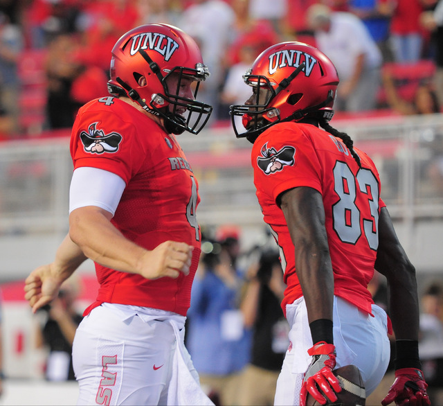 UNLV Rebels wide receiver Devonte Boyd (83) celebrates his first quarter touch down catch with quarterback Johnny Stanton (4) in the first quarter during the UNLV Jackson State football game in La ...