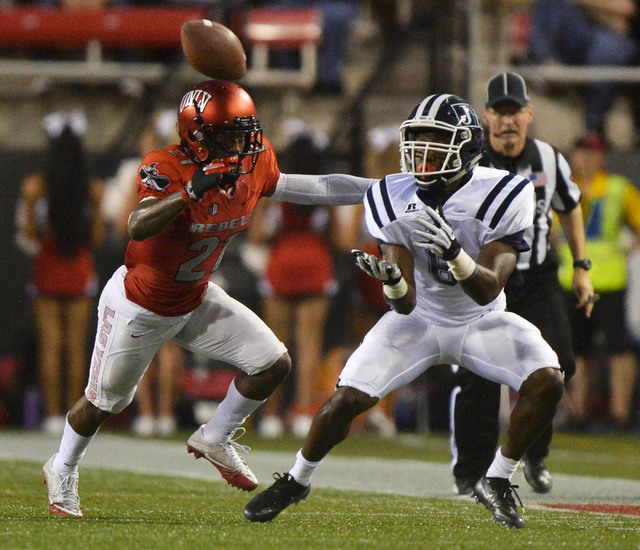 Jackson State Tigers wide receiver Devin Fosselman (6) catches a pass against UNLV Rebels defensive back Darius Mouton (21) in the first half during the UNLV Jackson State football game in Las Veg ...