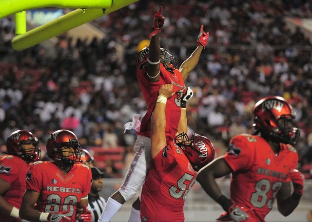 UNLV Rebels running back Lexington Thomas (3) is lifted by offensive lineman Will Kreitler (58) after a first-half rushing touchdown during the UNLV Jackson State football game in Las Vegas on Thu ...