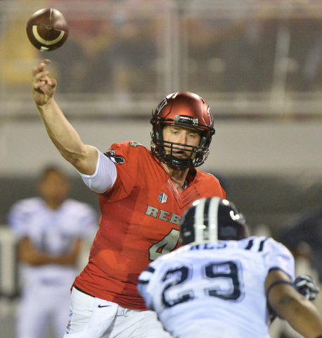 UNLV Rebels quarterback Johnny Stanton (4) throws a first quarter pass as Jackson State Tigers defensive end Javancy Jones (29) looks on during the UNLV Jackson State football game in Las Vegas on ...