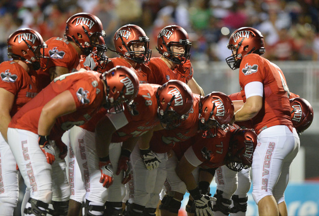 UNLV Rebels quarterback Johnny Stanton (4) huddles with the offense during the UNLV Jackson State football game in Las Vegas on Thursday, Sept. 1, 2016. Brett Le Blanc/Las Vegas Review-Journal Fol ...