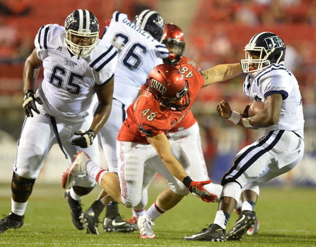 UNLV Rebels linebacker Bailey Laolagi (48) attempts to tackle Jackson State Tigers running back Jordan Johnson (17) in the third quarter during the UNLV Jackson State football game in Las Vegas on ...
