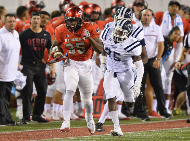 UNLV Rebels running back Xzaviar Campbell (35) runs down the sideline while being chased by Jackson State Tigers linebacker Tre Jester (25) during the UNLV Jackson State football game in Las Vegas ...
