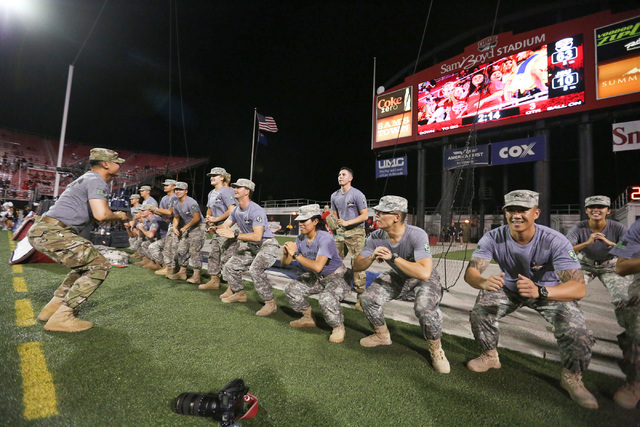 UNLV Army ROTC students do squats for every point UNLV scored after tiring of pushups from the 63 points UNLV scored on Jackson State football game in Las Vegas on Thursday, Sept. 1, 2016. Brett L ...