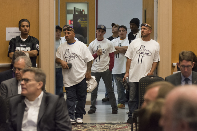 Raiders supporters watch during a Southern Nevada Tourism Infrastructure committee meeting at UNLV in Las Vegas to discuss the proposed $1.9 billion, 65,000-seat, domed stadium on Thursday, Sept.  ...