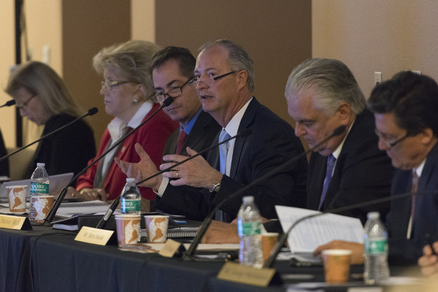 Southern Nevada Tourism Infrastructure committee chairman Steve Hill, center, speaks during a Southern Nevada Tourism Infrastructure committee meeting at UNLV in Las Vegas to discuss the proposed  ...