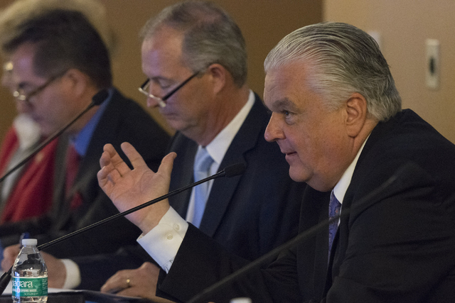 Southern Nevada Tourism Infrastructure committee member Steve Sisolak, right, speaks during a Southern Nevada Tourism Infrastructure committee meeting at UNLV in Las Vegas to discuss the proposed  ...