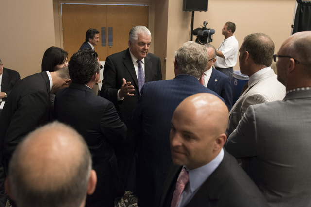 Southern Nevada Tourism Infrastructure committee member Steve Sisolak, center, speaks with committee members while on a break during a Southern Nevada Tourism Infrastructure committee meeting at U ...