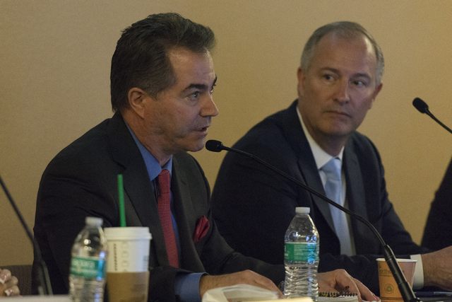 Southern Nevada Tourism Infrastructure vice chairman and president of UNLV, Len Jessup, left, speaks during a Southern Nevada Tourism Infrastructure committee meeting at UNLV in Las Vegas to discu ...