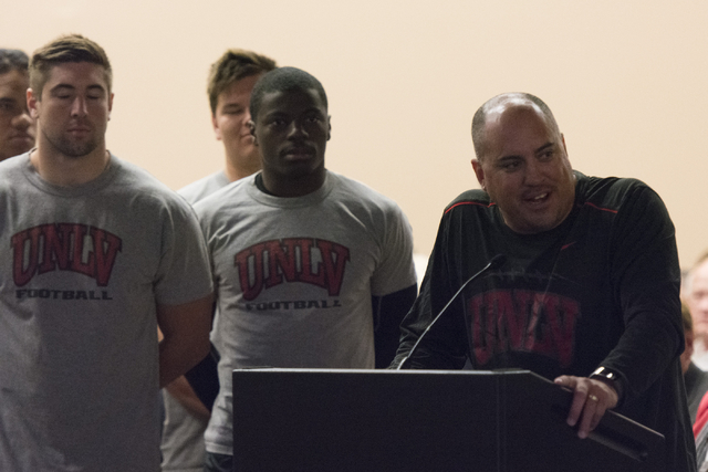 UNLV football head coach Tony Sanchez, right, speaks during a Southern Nevada Tourism Infrastructure committee meeting at UNLV in Las Vegas to discuss the proposed $1.9 billion, 65,000-seat, domed ...
