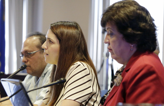 Jose Solorio, president of Political Advancement of Latino Organization, left, and Sylvia Lazos, policy director of Educate Nevada Now, listen as Amanda Morgan, legal director of Educate Nevada No ...