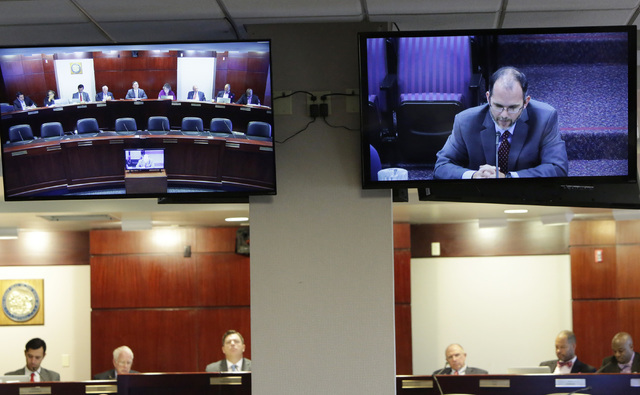 Superintendent of Public Instruction for the Nevada Department of Education Steve Canavero, right, testifies via video conference before the Legislative Commission on Friday, Sept. 9, 2016, at Gra ...