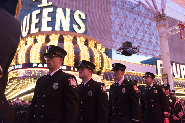 Members of Las Vegas Fire & Rescue march through Fremont Street Experience in downtown Las Vegas, Sunday, Sept. 11, 2016. The annual march honors the lives lost 15 years ago at the World Trade ...