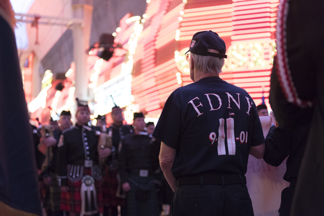 March participants head through Fremont Street Experience in downtown Las Vegas, Sunday, Sept. 11, 2016. The annual march honors the lives lost 15 years ago at the World Trade Center in New York C ...
