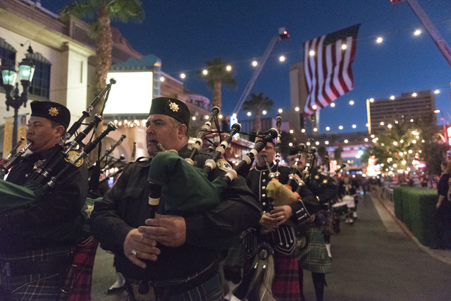 Members of the Henderson Fire Department Pipes and Drums march along 3rd Street at Ogden Avenue in downtown Las Vegas, Sunday, Sept. 11, 2016. The annual march honors the lives lost 15 years ago a ...