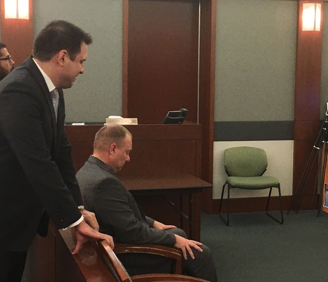 Metro officer James Burt, seated near defense attorney Frank Cofer, awaits a jury verdict at the Regional Justice Center on Sept. 22, 2016. Burt was acquitted of four felony charges. (David Ferrar ...