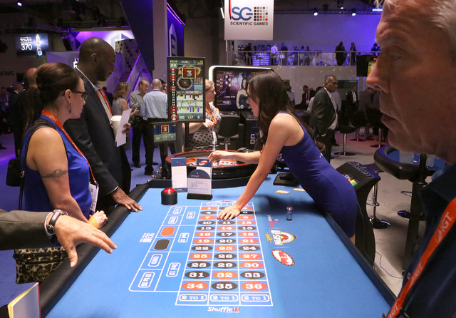 Expo-goers play roulette at Scientific Game booth during the Global Gaming Expo, Tuesday, Sept. 27, 2016, at the Sands Expo and Convention Center in Las Vegas. Bizuayehu Tesfaye/Las Vegas Review-J ...