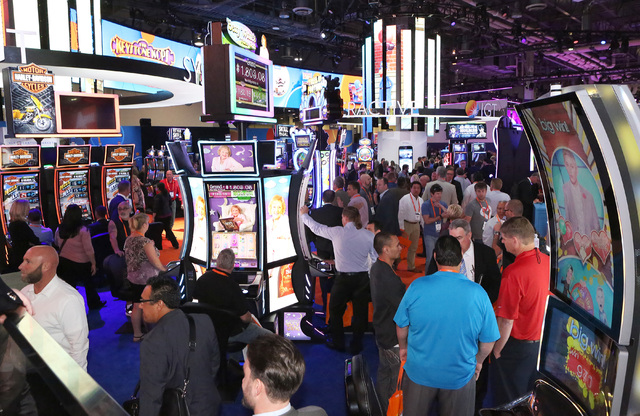 Expo-goers browse at the IGT booth during the Global Gaming Expo, Tuesday, Sept. 27, 2016, at the Sands Expo and Convention Center in Las Vegas. Bizuayehu Tesfaye/Las Vegas Review-Journal Follow @ ...