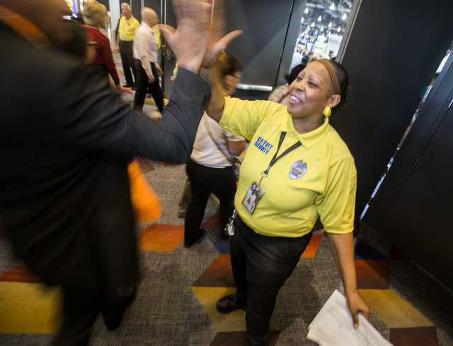 Security guard Ida Davis high-fives a man while he enters Global Gaming Expo at the Las Vegas Sands Expo and Convention Center on Tuesday , Sept. 27, 2016. She would repeatedly greet conventioneer ...