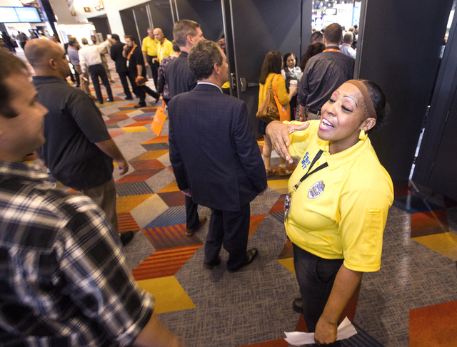 Security guard Ida Davis greets people entering Global Gaming Expo at the Las Vegas Sands Expo and Convention Center on Tuesday , Sept. 27, 2016. She would repeatedly greet conventioneers with &am ...