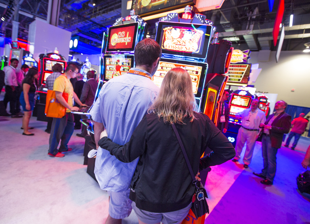 People play slots in the Scientific Games booth during Global Gaming Expo at the Las Vegas Sands Expo and Convention Center on Tuesday , Sept. 27, 2016. Jeff Scheid/Las Vegas Review-Journal Follow ...