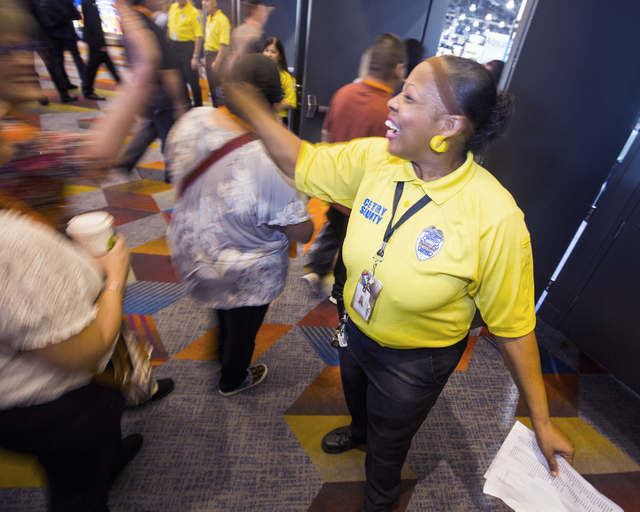 Security guard Ida Davis high-fives a woman while she enters Global Gaming Expo at the Las Vegas Sands Expo and Convention Center on Tuesday , Sept. 27, 2016. She would repeatedly greet convention ...